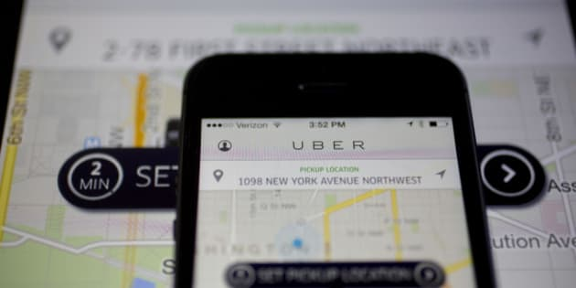 The Uber Technologies Inc. application is displayed on an Apple Inc. iPhone 5s and iPad Air in this arranged photograph in Washington, D.C., U.S., on Wednesday, March 5, 2014. Uber, a startup that lets drivers pick up passengers with their personal cars and that was valued at $3.5 billion in a funding round last year, has raised $307 million from a group of backers that include Google Ventures, Google Inc.'s investment arm, and Jeff Bezos, the founder of Amazon. Photographer: Andrew Harrer/Bloomberg via Getty Images