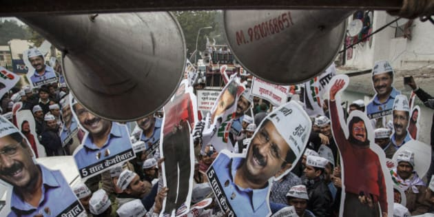Aam Aadmi Party (AAP), or Common Man's Party supporters carry portraits of party chief Arvind Kerjiwal during a road show ahead of filing his nomination papers for the Delhi state elections in New Delhi, India, Tuesday, Jan. 20, 2015. Delhi elections begins on February 7. (AP Photo/Tsering Topgyal)