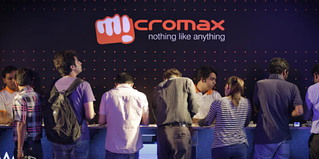 Attendees stand at a counter while looking at the Micromax Informatics Ltd. Canvas Nitro smartphone displayed during a launch event in New Delhi, India, on Monday, Sept. 8, 2014. Micromax led the Indian mobile phone market for the first time in the second quarter, accounting for 16.6 percent of shipments, compared with Samsung Electronics Co.'s 14.4 percent, Counterpoint Research said in a statement on its website. Photographer: Kuni Takahashi/Bloomberg via Getty Images