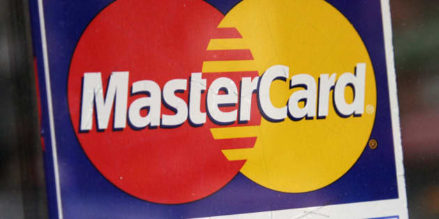 In this Jan. 21, 2015 photo, a sign indicating MasterCard credit cards are accepted is posted at a New York business. MasterCard on Friday, Jan. 30, 2015, reported fourth-quarter profit of $801 million. (AP Photo/Mark Lennihan)