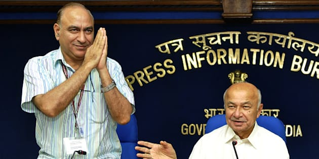 NEW DELHI, INDIA - AUGUST 1: Union Home Minister Sushilkumar Shinde with the new Home Secretary Anil Goswami (L) at the monthly press conference of their ministry at Shastri Bhawan on August 1, 2013 in New Delhi, India. 72-year-old Shinde, who became the country's Home Minister on July 31 last year succeeding P Chidambaram suggested he was a good team leader and he takes criticism in his stride. (Photo by Sonu Mehta/Hindustan Times via Getty Images)