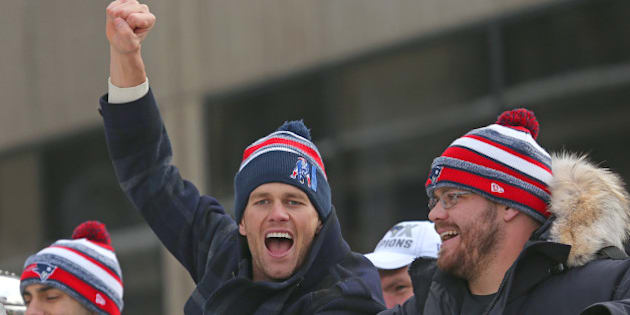 BOSTON - FEBRUARY 4: Patriots quarterback Tom Brady cheers as the Super Bowl victory parade continues down Tremont Street. (Photo by David L. Ryan/The Boston Globe via Getty Images)