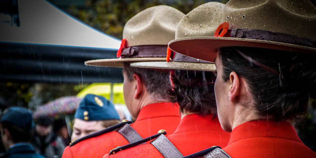 Members of the RCMP Ladysmith Detachment wearing their Red Serge dress uniform.