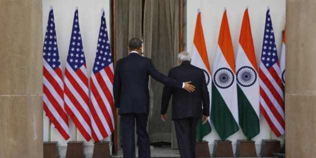 U.S. President Barack Obama, left and Indian Prime Minister Narendra Modi walk into the Hyderabad House, the venue of their talks in New Delhi, India, Sunday, Jan. 25, 2015. Obama's arrival Sunday morning in the bustling capital of New Delhi marked the first time an American leader has visited India twice during his presidency. Obama is also the first to be invited to attend India's Republic Day festivities, which commence Monday and mark the anniversary of the enactment of the country's democratic constitution. (AP Photo/Manish Swarup)