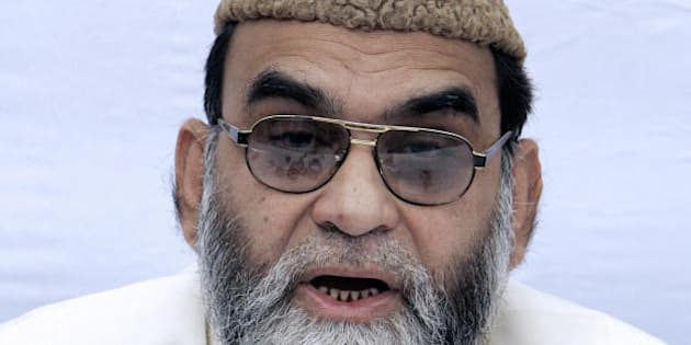 New Delhi, INDIA:  Shahi Imam of New Delhi's Jama Masjid Mosque Maulana Syed Ahmed Bukhari gestures while addressing media representatives at the Jama Masjid complex in New Delhi, 14 February 2006.  Bukhari discussed various issues including the educational, social, political and economic rights of the Muslim people in India.          AFP PHOTO/ Prakash SINGH  (Photo credit should read PRAKASH SINGH/AFP/Getty Images)