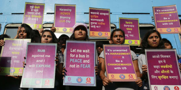 Indian students hold placards during a rally to mark the second anniversary of the deadly gang rape of a student on a bus in New Delhi, in Mumbai, India,Tuesday, Dec. 16, 2014.The case sparked public outrage and helped make women's safety a common topic of conversation in a country where rape is often viewed as a woman's personal shame to bear. (AP Photo/Rafiq Maqbool)