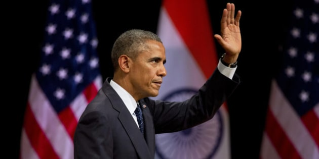 "U.S. President Barack Obama waves to the audience after delivering a speech at the Siri Fort Auditorium, a government-run event center, in New Delhi, India, Tuesday, Jan. 27, 2015. Obama gently nudged India Tuesday to fulfill its constitution's pledge to uphold the ""dignity of the individual,"" drawing on his own experience as a minority in the United States as he closed out a three-day visit to New Delhi. (AP Photo/Saurabh Das)"