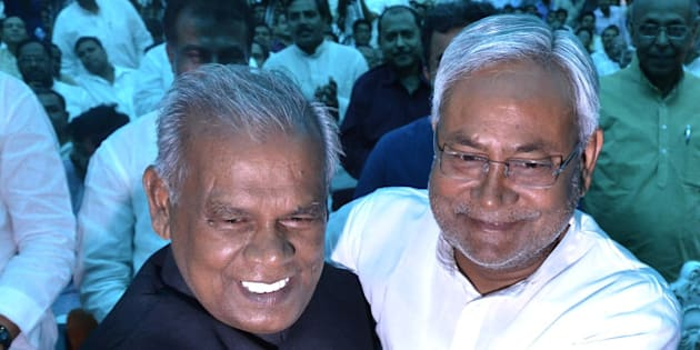 PATNA, INDIA - MAY 20: JD-U leader Jitan Ram Manjhi (L) with Nitish Kumar during his sworn-in ceremony as the new Chief Minister of Bihar, on May 20, 2014 in Patna, India. Manjhi currently hold the SC/ST, OBS, EBC Welfare Ministry. He is a Mahadalit from the Musahar community who occupy the lowest strata of the society in the state. Nitish Kumar, who quit as Bihar's Chief Minister after his Janata Dal United lost the national election, has chosen his close aide Jitan Ram Manjhi as his successor. (Photo by Santosh Kumar/Hindustan Times via Getty Images)