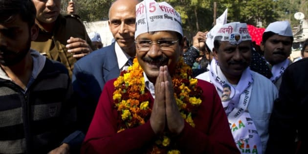 Aam Aadmi Party, or Common Man Party, leader Arvind Kejriwal, center, campaigns ahead of Delhi state elections in New Delhi, India, Thursday, Feb. 5, 2015. Delhi goes to the polls on Feb. 7. (AP Photo/Saurabh Das)