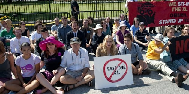American actress Daryl Hannah (C) sits in front of the White House in Washington, DC, August 30, 2011, during a protest against the construction of the Keystone XL pipeline. Hannah was among dozens of protestors arrested in a demonstration against the oil pipeline which, if constructed, would run from Alberta's oilsands in Canada to Texas. AFP PHOTO / Saul LOEB (Photo credit should read SAUL LOEB/AFP/Getty Images)