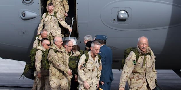 The last Canadian troops to leave Afghanistan, deplane as they return to Canadian soil, in Ottawa, Ontario on March 18, 2014.  The last Canadian troops deployed to Afghanistan returned home on Tuesday, bringing an end to Canada's longest ever military engagement. AFP PHOTO/ Cole Burston        (Photo credit should read Cole Burston/AFP/Getty Images)