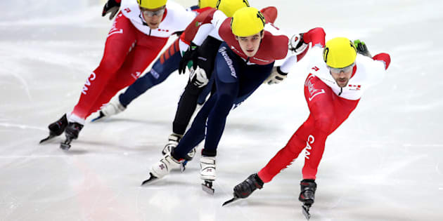 DRESDEN, GERMANY - FEBRUARY 08:  #120 Francois Hamelin of Canada (R) leads the pack down the straight during the Men's 500m Mens A final on day 2 of the ISU World Cup Short Track Speed Skating on February 8, 2015 in Dresden, Germany.  (Photo by Jordan Mansfield - ISU/Getty Images for ISU)
