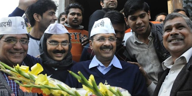 NEW DELHI, INDIA - FEBRUARY 8: AAP leader Arvind Kejriwal with his look alike Jitendra Kumar, actor after programme recording at Kaushambi, Ghaziabad on February 8, 2015 in New Delhi, India. The former Delhi chief minister obliged his admirers and posed for pictures and selfies with them. According to exit polls, AAP appears set for a sweeping victory in the Delhi Assembly elections for which voting took place. (Photo by Sushil Kumar/Hindustan Times via Getty Images)