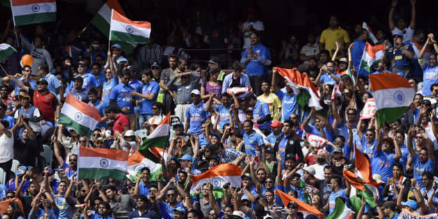 Indian fans cheer on their team while playing against Australia during their one-day international cricket match in Melbourne, Australia  Sunday, Jan. 18, 2015. (AP Photo/Andy Brownbill)