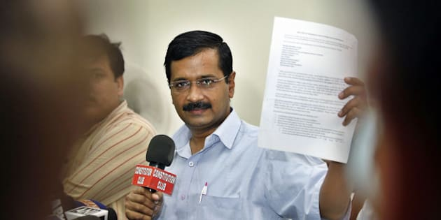 NEW DELHI, INDIA - OCTOBER 27: AAP Chief Arvind Kejriwal showing press release during the press conference on affidavit by government in Supreme Court on black money on October 27, 2014 in New Delhi, India. In its affidavit to the Supreme Court, the Indian government revealed the names of three individuals allegedly having Swiss bank account. Arvind Kejriwal accused government of selectively disclosing the names to protect some influential people. (Photo by Raj K Raj/Hindustan Times via Getty Images)