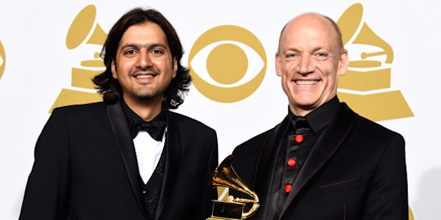 LOS ANGELES, CA - FEBRUARY 08:  Musicians Ricky Kej (L) and Wouter Kellerman, winners of the Best New Age Album Award for 'Winds of Samsara' pose in the press room during The 57th Annual GRAMMY Awards at the STAPLES Center on February 8, 2015 in Los Angeles, California.  (Photo by Frazer Harrison/Getty Images)