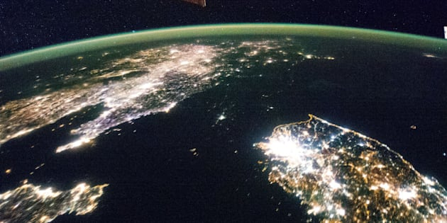 """Flying over East Asia, an Expedition 38 crew member on the International Space Station took this night image of the Korean Peninsula. Unlike daylight images, city lights at night illustrate dramatically the relative economic importance of cities, as gauged by relative size. In this north-looking view, it is immediately obvious that greater Seoul is a major city and that the port of Gunsan is minor by comparison. There are 25.6 million people in the Seoul metropolitan area-more than half of South Korea's citizens-while Gunsan's population is 280,000. North Korea is almost completely dark compared to neighboring South Korea and China. The darkened land appears as if it were a patch of water joining the Yellow Sea to the Sea of Japan. The capital city, Pyongyang, appears like a small island, despite a population of 3.26 million (as of 2008). The light emission from Pyongyang is equivalent to the smaller towns in South Korea. Coastlines are often very apparent in night imagery, as shown by South Korea's eastern shoreline. But the coast of North Korea is difficult to detect. These differences are illustrated in per capita power consumption in the two countries, with South Korea at 10,162 kilowatt hours and North Korea at 739 kilowatt hours.  Image credit: NASA   Original image: <a href=""""http://www.flickr.com/photos/nasa2explore/12752402055/in/set-72157629601396498"""">www.flickr.com/photos/nasa2explore/12752402055/in/set-721...</a>  More about space station research: <a href=""""http://www.nasa.gov/mission_pages/station/research/index.html"""" rel=""""nofollow"""">www.nasa.gov/mission_pages/station/research/index.html</a>  View more photos like this in the """"NASA Earth Images"""" Flickr photoset: <a href=""""http://www.flickr.com/photos/28634332@N05"""">www.flickr.com/photos/28634332@N05</a>  ________________________________ These official NASA photographs are being made available for publication by news organizations and/or for personal use printing by the subject(s) of the photographs. The pho"""