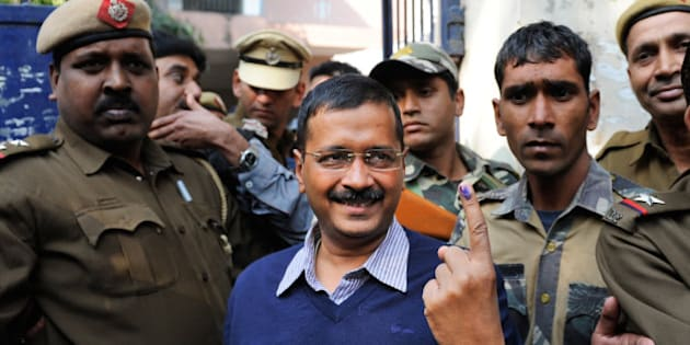 Aam Aadmi Party, or Common Man's Party, leader Arvind Kejriwal displays the indelible ink mark on his finger after casting his vote in New Delhi, India, Saturday, Feb. 7, 2015. Voters cast ballots in the Indian capital on Saturday in an election that is seen as a litmus test for the popularity of Prime Minister Narendra Modi and his Hindu nationalist party. Opinion polls ahead of the vote to choose New Delhi's 70-member assembly suggest that Modi's Bharatiya Janata Party is either locked in a close contest with the upstart Common Man's Party or will come in second. (AP Photo/Altaf Qadri)