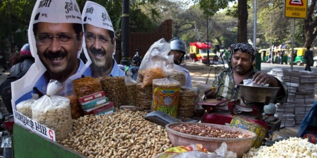 Cut out photographs of Aam Aadmi Party, or Common Man Party, leader Arvind Kejriwal, adorns the cart of a street vendor ahead of Delhi state elections in New Delhi, India, Thursday, Feb. 5, 2015. Delhi goes to the polls on Feb. 7. (AP Photo/Saurabh Das)