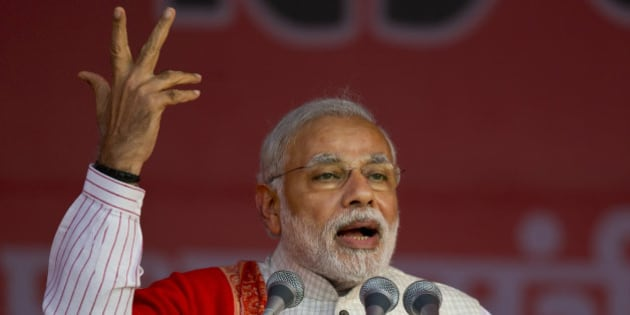 Indian Prime Minister Narendra Modi addresses an election campaign rally for his Bharatiya Janata Party (BJP) ahead of Delhi state election in New Delhi, India, Wednesday, Feb. 4, 2015. Delhi goes to the polls on Feb. 7. (AP Photo/Saurabh Das)