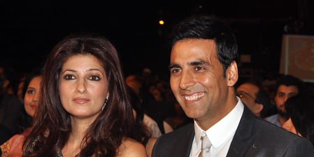 Indian Bollywood Akshay Kumar (R) and wife Twinkle Khanna (L) look on as they attend the 'Stardust Awards 2011' ceremony in Mumbai on February 6, 2011. AFP PHOTO/STR (Photo credit should read STRDEL/AFP/Getty Images)