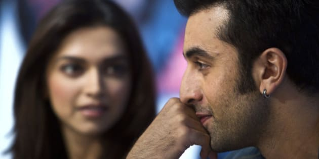 """Indian Bollywood actor Ranbir Kapoor gestures next to actress Deepika Padukone during a press conference held to promote their new Hindi film """"Yeh Jawani Hai Deewani"""" in New Delhi, India, Monday, May 27, 2013. The film will be released on May 31, 2013. (AP Photo/Tsering Topgyal)"""