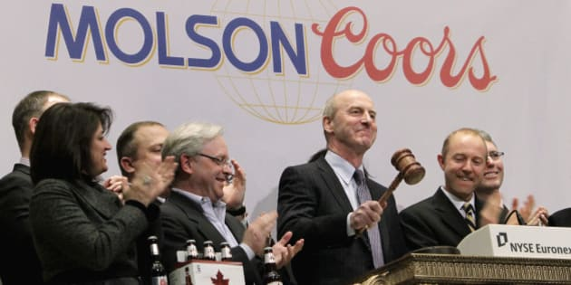 Peter Swinburn, president and chief executive officer of Molson Coors Brewing Company, pounds the gavel at the close of trading at the New York Stock Exchange Thursday, March 3, 2011. (AP Photo/Richard Drew)