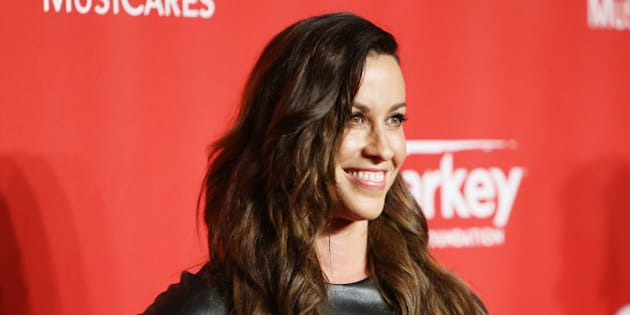 LOS ANGELES, CA - FEBRUARY 06:  Alanis Morissette arrives at the 2015 MusiCares Person of The Year honoring Bob Dylan held at Los Angeles Convention Center on February 6, 2015 in Los Angeles, California.  (Photo by Michael Tran/FilmMagic)