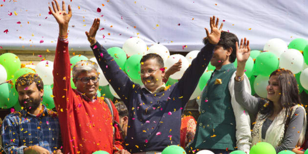 """Leader of the Aam Aadmi Party, or Common Man's Party, Arvind Kejriwal, center, waves to the crowd as his party looks set for a landslide party in New Delhi, India, Tuesday, Feb. 10, 2015. The upstart anti-corruption party appeared set  to install a state government in India's capital in a huge blow for Prime Minister Narendra Modi's Hindu nationalist party. As early trends pointed to an overwhelming win for the AAP, the party's jubilant supporters began cheering and dancing in celebration, yelling """"Five Years Kejriwal."""" (AP Photo/Manish Swarup)"""