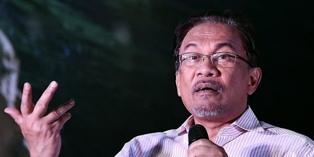 Malaysian opposition leader Anwar Ibrahim gestures while addressing his supporters at a gathering in Kuala Lumpur on February 9, 2015. Malaysia's highest court is expected to deliver a final decision on February 10, on Anwar's appeal against a sodomy conviction and five-year jail term handed down last year.   AFP PHOTO / MANAN VATSYAYANA        (Photo credit should read MANAN VATSYAYANA/AFP/Getty Images)