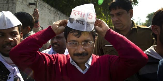 Aam Aadmi Party, or Common Man Party, leader Arvind Kejriwal, adjusts his cap while campaigning ahead of Delhi state elections in New Delhi, India, Thursday, Feb. 5, 2015. Delhi goes to the polls on Feb. 7. (AP Photo/Saurabh Das)