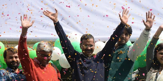 NEW DELHI,INDIA FEBRUARY 10: Aam Aadmi Party (AAP) chief and its chief ministerial candidate for Delhi, Arvind Kejriwal (C) waving to his supporters in New Delhi.(Photo by Pankaj Nangia/India Today Group/Getty Images)