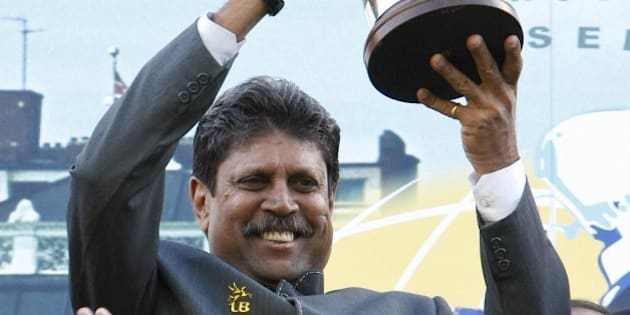 Kapil Dev, captain of the 1983 World Cup winning Indian cricket team holds up the actual cup won in 1983 at Lords Cricket ground, in London, on June 25, 2008. Twenty-five years ago today India unexpectedly beat the West Indies in the cricket World Cup final.  AFP PHOTO/Frantzesco Kangaris (Photo credit should read FRANTZESCO KANGARIS/AFP/Getty Images)