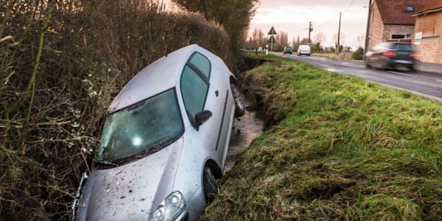 A car lies in a ditch following an accident in the northern French village of Meteren, on January 29, 2015. AFP PHOTO / PHILIPPE HUGUEN        (Photo credit should read PHILIPPE HUGUEN/AFP/Getty Images)