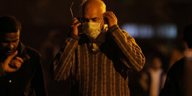 NEW DELHI, INDIA - FEBRUARY 17: A man wearing a mask as a precaution measure against swine flu virus, at a RML hospital on February 17, 2013 in New Delhi, India. According to local reports, two more people succumbed to swine flu in the city, taking the death toll to nine. (Photo by Sanjeev Verma/Hindustan Times via Getty Images)