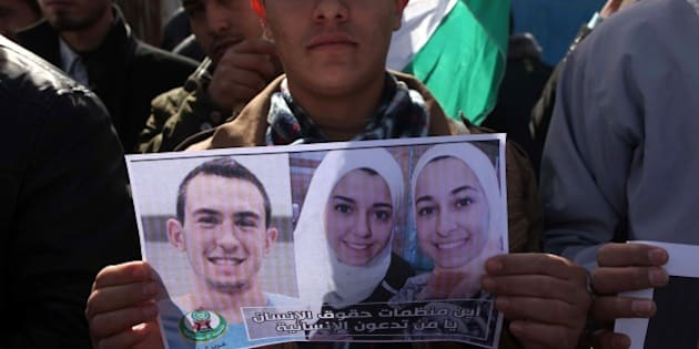 GAZA CITY, GAZA - FEBRUARY 12: A group of Palestinians protest against the Chapel Hill shooting, in front of the United Nations office in Gaza City, Gaza on February 12, 2015. Three young Muslim Students, Deah Shaddy Barakat, his wife Yusor Mohammad, and her sister Razan Mohammad Abu-Salha were killed on 10th of February 2015 in Chapel Hill, North Carolina, United States at their home on 10th of February 2015.  A 46-year-old man was charged with the murder of three Muslim students who were fatally shot Tuesday at the University of North Carolinas residential complex in Chapel Hill, police said Wednesday. (Photo by Ashraf Amra/Anadolu Agency/Getty Images)