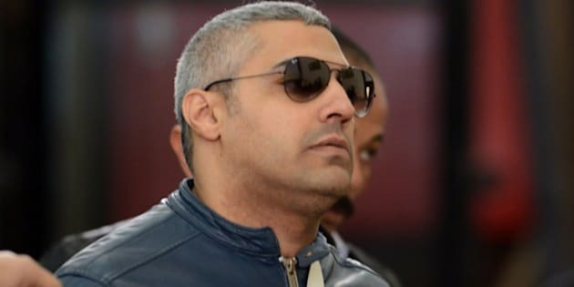 Al-Jazeera journalist Egyptian-Canadian Mohamed Fahmy arrives at the court in Cairo for his retrial on February 12, 2015. An Egyptian court ordered the release of two Al-Jazeera journalists pending their retrial for allegedly supporting the banned Muslim Brotherhood. Fahmy was ordered to pay bail of 250,000 Egyptian pounds ($33,000) while Egyptian Baher Mohamed was released on his own recognisance along with other defendants.  AFP PHOTO/ MOHAMED EL-SHAHED        (Photo credit should read MOHAMED EL-SHAHED/AFP/Getty Images)