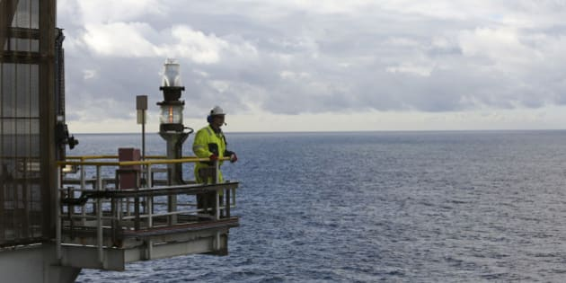 An employee looks out across the North Sea natural gas and oil field from the Troll A offshore gas platform, operated by Statoil ASA, near Bergen, Norway, on Thursday, Oct. 11, 2012. Statoil is holding talks with OAO Gazprom on how to make the Shtokman natural gas project in the Russian Arctic economically viable after the partners delayed the development over costs. Photographer: Chris Ratcliffe/Bloomberg via Getty Images