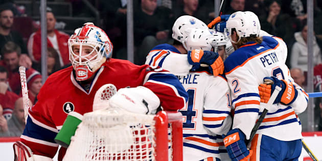 MONTREAL, QC - FEBRUARY 12: Ryan Nugent-Hopkins #93 of the Edmonton Oilers celebrate with teammates after scoring a goal against the Montreal Canadiens in the NHL game at the Bell Centre on February 12, 2015 in Montreal, Quebec, Canada. (Photo by Francois Lacasse/NHLI via Getty Images)