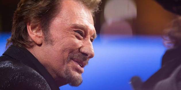 PARIS, FRANCE - DECEMBER 06:  Singer Johnny Hallyday attends the 'France Television Telethon 2014' TV show on December 6, 2014 in Paris, France.  (Photo by Richard Bord/Getty Images)