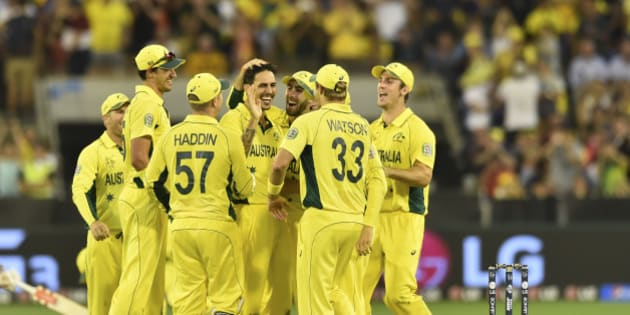 Australia's Mitchell Johnson center, is congratulated by team mates after taking a wicket during their Cricket World Cup pool A match against England in Melbourne, Australia, Saturday, Feb. 14, 2015. (AP Photo/Theo Karanikos)