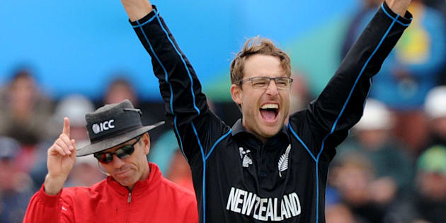 New Zealand's Daniel Vettori, right, celebrates the wicket, confirmed by umpire Nigel Long, left, of Sri Lanka's Mahela Jayawardene for no score during the opening match of the Cricket World Cup at Christchurch, New Zealand, Saturday, Feb. 14, 2015. (AP Photo/Ross Setford)