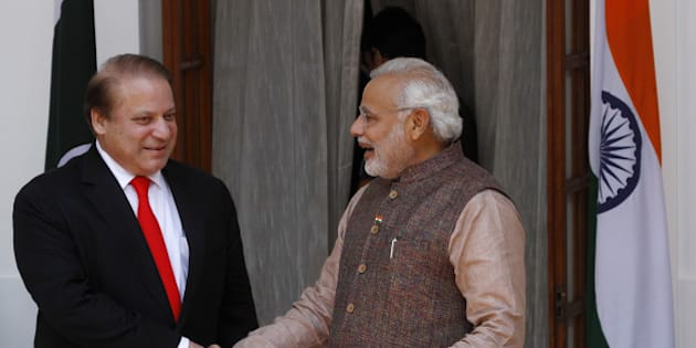 NEW DELHI, INDIA - MAY 27: Indian Prime Minister Narendra Modi (L) shakes hand with his Pakistani counterpart Nawaz Sharif before the start of their bilateral meeting at Hyderabad House on May 27, 2014 in New Delhi, India. New Indian Prime Minister Narendra Modi met with the leaders of rival Pakistan and other neighboring nations a day after being sworn in. (Photo by Sanjeev Verma/Hindustan Times via Getty Images)