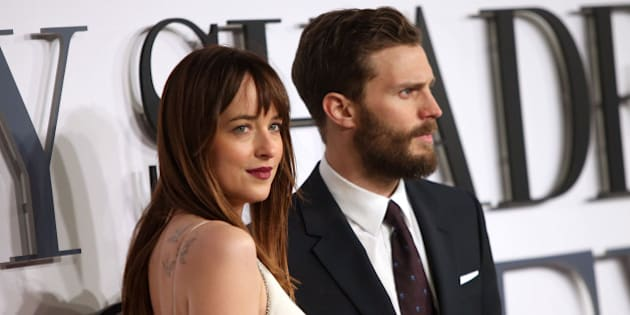 Jamie Dornan and Dakota Johnson pose for photographers upon arrival at the UK premiere of the film 'Fifty Shades of Grey' in London, Thursday, Feb. 12, 2015. (Photo by Joel Ryan/Invision for Universal Pictures/AP Images)