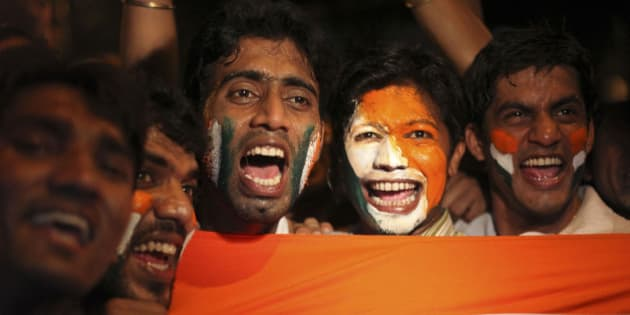 """Indians celebrate after their team won the ICC World Cup cricket semifinal match against Pakistan, in Mumbai, India, Wednesday, March 30, 2011. India upstaged archrival Pakistan by 29 runs in the so-called """"mother of all World Cup matches"""" to progress to the final against Sri Lanka, giving Sachin Tendulkar another chance to reach his 100th hundred after his charmed innings fell just short on Wednesday. (AP Photo/Rafiq Maqbool)"""