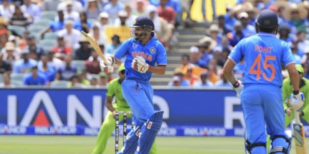 India's Shikhar Dhawan, center, watches a shot during the World Cup Pool B match between India and Pakistan in Adelaide, Australia, Sunday, Feb. 15, 2015. (AP Photo/James Elsby)