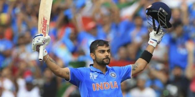 India's Virat Kohli, celebrates his hundred runs during the World Cup Pool B match against Pakistan in Adelaide, Australia, Sunday, Feb. 15, 2015. (AP Photo/James Elsby)