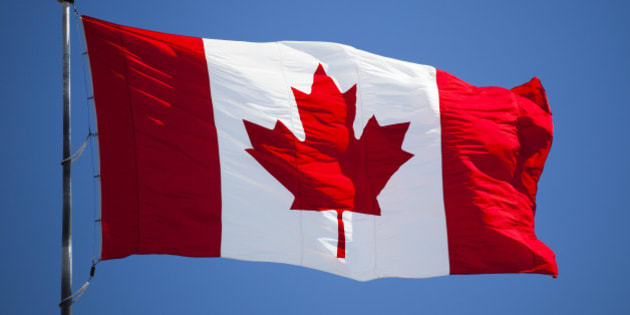 Maple leaf flag flying in the wind.