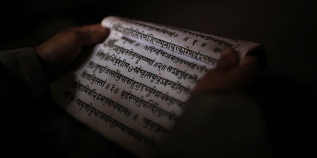 A young student studies Sanskrit scripts while attending class at Budhanilkantha Vedh Vidhya ashram, a school imparting vedic knowledge and attached to the Budhanilkantha temple, in Katmandu, Nepal, Monday, June 10, 2013. Budhanilkantha is believed to be an incarnation of Hindu god Vishnu and is one of the most important pilgrimage sites for Hindus. (AP Photo/Niranjan Shrestha)