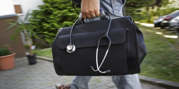 ZEHDENICK, GERMANY - JULY 24: A doctor carries his bag with a stethoscope on July 24, 2013 in Zehdenick, Germany. (Photo by Thomas Trutschel/Photothek via Getty Images)